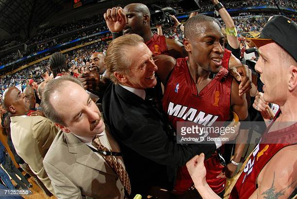 Head coach Pat Riley, Dwyane Wade and Jason Williams of the Miami Heat celebrate their 95-92 Game Six victory of the 2006 NBA Finals against the...