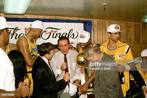 Head Coach Pat Riley of the Los Angeles Lakers speaks with the media during their locker room celebration after winning the 1987 NBA finals against...