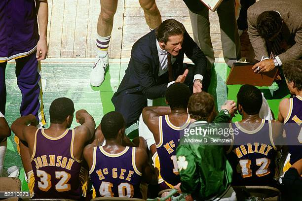 Head Coach Pat Riley of the Los Angeles Lakers talks with his team during a timeout in an NBA game against the Boston Celtics circa 1984 at the...