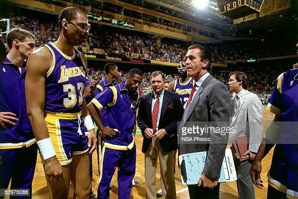 Head Coach Pat Riley of the Los Angeles Lakers talks with Kareem AbdulJabbar prior to playing against the Boston Celtics in the 1987 NBA Finals on...