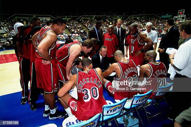 Head coach Pat Riley of the Miami Heat discusses team strategy in the huddle during an exhibition game against Maccabi Tel Aviv at the Yad Eliyahu...