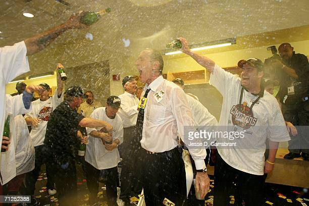 Head coach Pat Riley of the Miami Heat is sprayed with champange in the locker room as he celebrates winning the NBA Championship after their 9592...