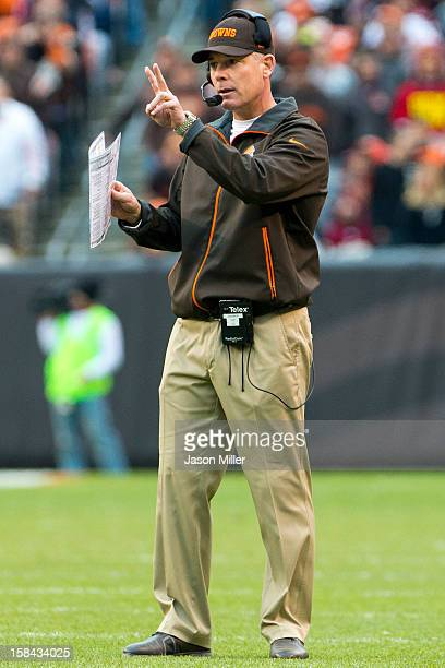 Head coach Pat Shurmur of the Cleveland Browns signals to his players during the first half against the Washington Redskins at Cleveland Browns...