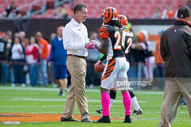 Head coach Pat Shurmur of the Cleveland Browns talks to cornerback Adam Jones of the Cincinnati Bengals prior to the game at Cleveland Browns Stadium...