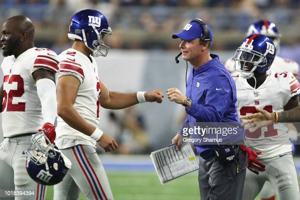 Head coach Pat Shurmur of the New York Giants celebrates a field goal with Aldrick Rosas during the first half while playing the Detroit Lions during...