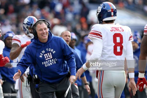 Head coach Pat Shurmur of the New York Giants celebrates with Daniel Jones after scoring a touchdown in the second quarter against the Chicago Bears...