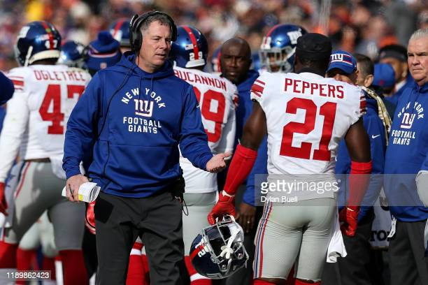 Head coach Pat Shurmur of the New York Giants celebrates with Jabrill Peppers in the second quarter against the Chicago Bears at Soldier Field on...