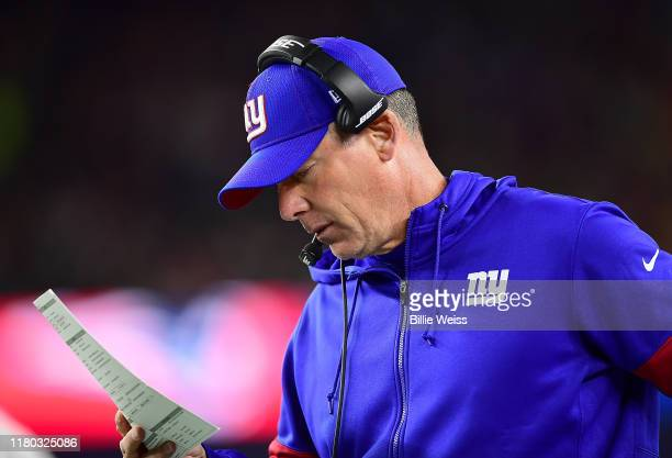 Head coach Pat Shurmur of the New York Giants looks on against the New England Patriots during the second quarter in the game at Gillette Stadium on...
