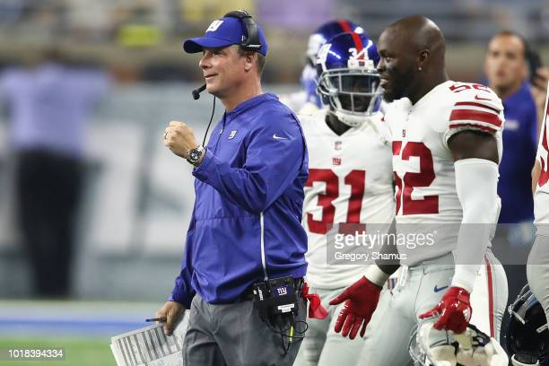Head coach Pat Shurmur of the New York Giants reacts to a field goal during the first half while playing the Detroit Lions during a pre season game...