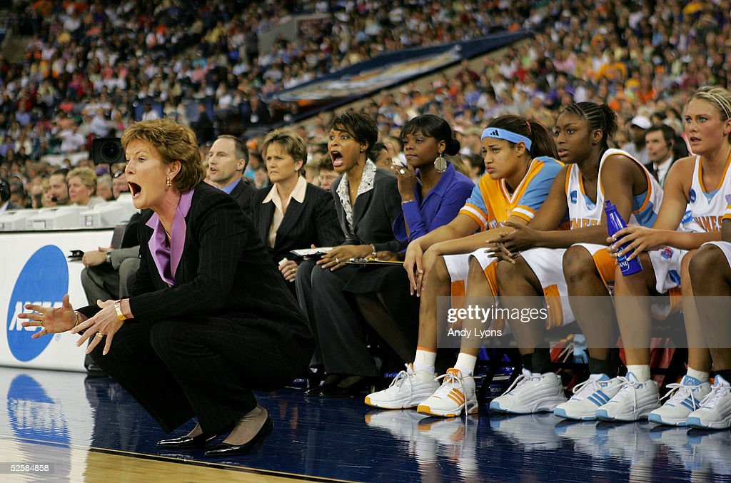 Head coach Pat Summitt, Assistant coaches Dean Lockwood, Holly Warlick and Nikki Caldwell of the Tennessee Lady Vols react to a play in the Semifinal game of the Women's NCAA Basketball Championship against the Michigan State Spartans on April 3, 2005 at the RCA Dome in Indianapolis, Indiana.
