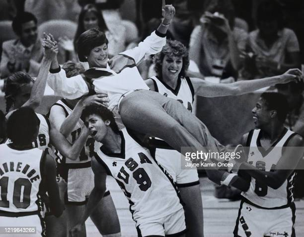 Head coach Pat Summitt is lifted by Cheryl Miller and her teammates as they celebrate winning the gold medal for the victory over Korea in the 1984...