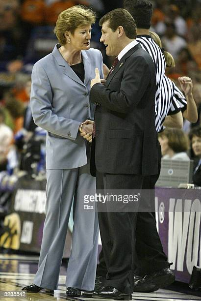 Head coach Pat Summitt of the Tennessee Lady Vols and head coach Geno Auriemma of the University of Connecticut Huskies meet before the National...