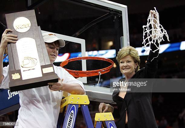 Head coach Pat Summitt of the Tennessee Lady Volunteers and her son Tyler celebrate after cutting down the net after Tennessee's 5946 win against the...
