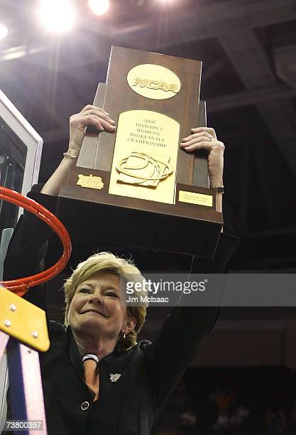 Head coach Pat Summitt of the Tennessee Lady Volunteers celebrates with the trophy after after Tennessee's 5946 win against the Rutgers Scarlet...