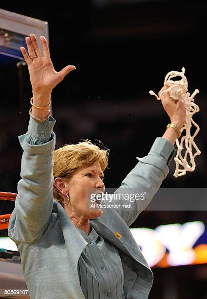 Head coach Pat Summitt of the Tennessee Lady Volunteers celebrates cutting down the net after their 6448 win against the Stanford Cardinal during the...