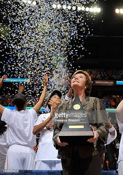 Head coach Pat Summitt of the Tennessee Volunteers holds the championship trophy after winning the SEC Women's Basketball Tournament Championship...
