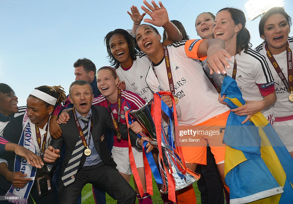 Head coach Patrice Lair of Olympique Lyonnais celebrates with his players after winning the UEFA Women's Champions League Final at Olympiastadion on May 17, 2012 in Munich, Germany.