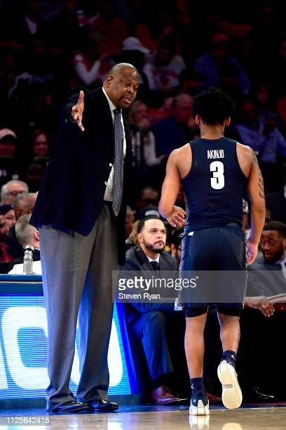 Head coach Patrick Ewing of the Georgetown Hoyas speaks with James Akinjo against the St John's Red Storm at Madison Square Garden on January 27 2019...