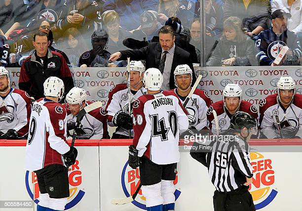 Head Coach Patrick Roy of the Colorado Avalanche gives instructions to Matt Duchene and Alex Tanguay during a second period stoppage in play against...