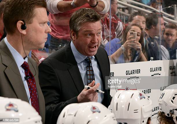 Head coach Patrick Roy of the Colorado Avalanche talks with his player during a third period time out against the Arizona Coyotes at Gila River Arena...