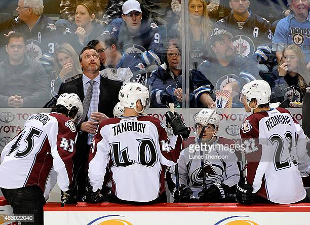 Head Coach Patrick Roy of the Colorado Avalanche watches a replay on the Jumbotron during second period action against the Winnipeg Jets on February...