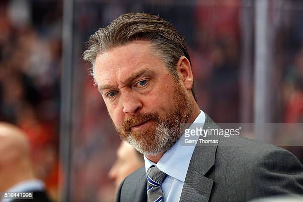 Head coach Patrick Roy of the Colorado Avalanche watches from the bench during an NHL game against the Calgary Flames at Scotiabank Saddledome on...