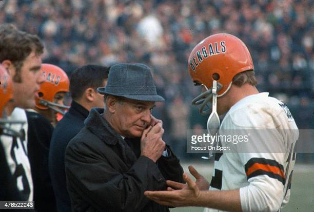 Head Coach Paul Brown of the Cincinnati Bengals talks with his quarterback Greg Cook on the sidelines during an AFL Football game circa 1969 Brown...