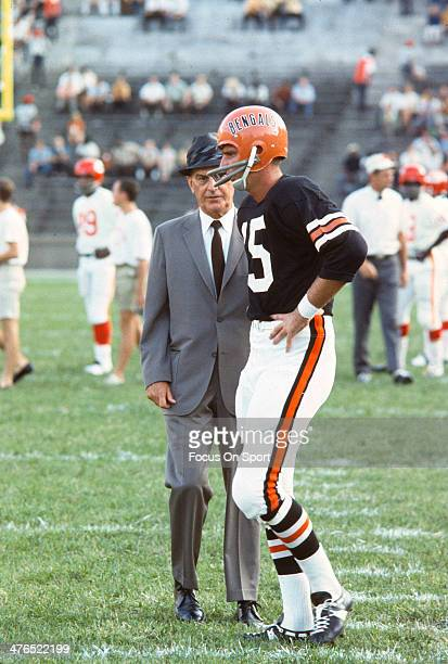 Head Coach Paul Brown of the Cincinnati Bengals talks with quarterback John Stofa during warms up prior to playing an AFL Football game against the...