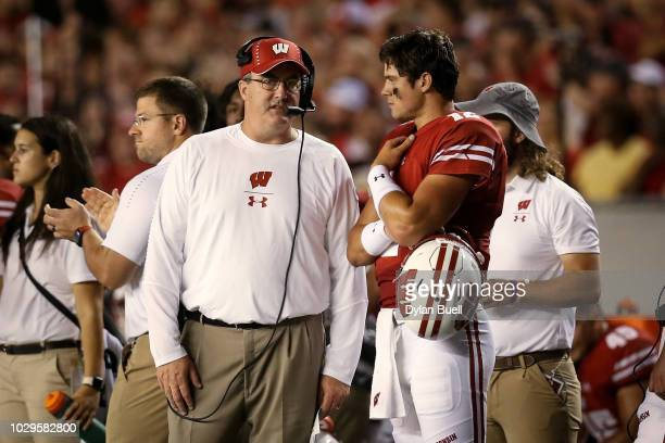 Head coach Paul Chryst and Alex Hornibrook of the Wisconsin Badgers meet in the second quarter against the Western Kentucky Hilltoppers at Camp...