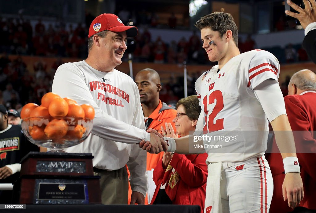 Head coach Paul Chryst and Alex Hornibrook #12 of the Wisconsin Badgers celebrates after winning the 2017 Capital One Orange Bowl against the Miami Hurricanes at Hard Rock Stadium on December 30, 2017 in Miami Gardens, Florida.