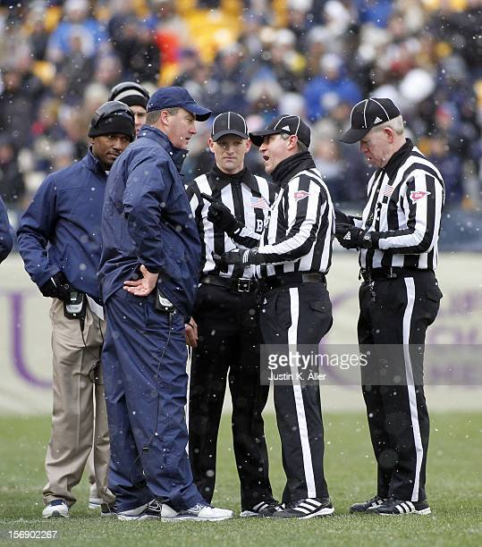 Head coach Paul Chryst of the Pittsburgh Panthers argues with referees against the Rutgers Scarlet Knights during the game on November 24 2012 at...