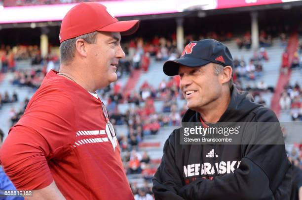 Head coach Paul Chryst of the Wisconsin Badgers and head coach Mike Riley of the Nebraska Cornhuskers meet before the game at Memorial Stadium on...