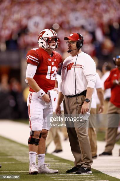 Head coach Paul Chryst of the Wisconsin Badgers talks with quarterback Alex Hornibrook as they take on the Ohio State Buckeyes during the Big Ten...