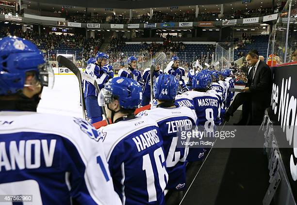 Head Coach Paul Fixter of the Sudbury Wolves talks to his players during an OHL game between the Sudbury Wolves and the Niagara Ice Dogs at the...