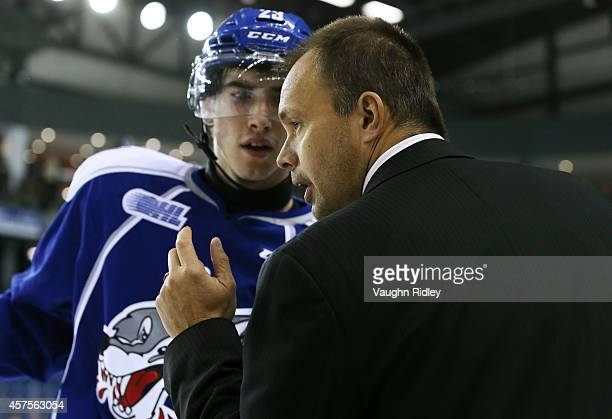 Head Coach Paul Fixter of the Sudbury Wolves talks to Kyle Capobianco during an OHL game between the Sudbury Wolves and the Niagara Ice Dogs at the...