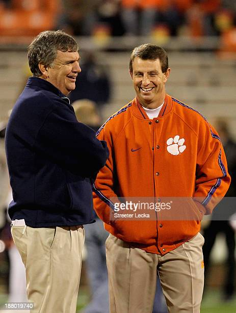 Head coach Paul Johnson of the Georgia Tech Yellow Jackets and Dabo Swinney of the Clemson Tigers talk before their game at Clemson Memorial Stadium...