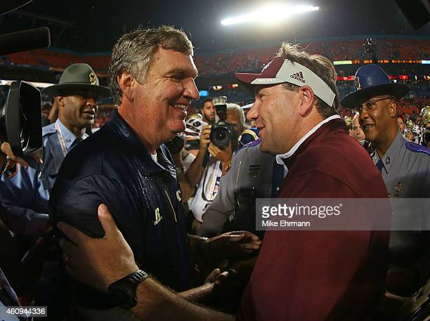 Head coach Paul Johnson of the Georgia Tech Yellow Jackets and head coach Dan Mullen of the Mississippi State Bulldogs shake hands after the Capital...