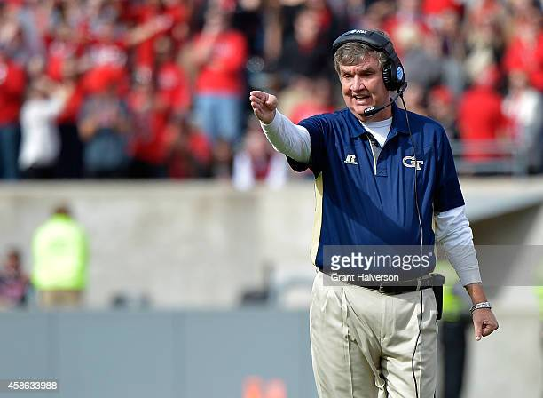 Head coach Paul Johnson of the Georgia Tech Yellow Jackets directs his team against the North Carolina State Wolfpack during their game at...