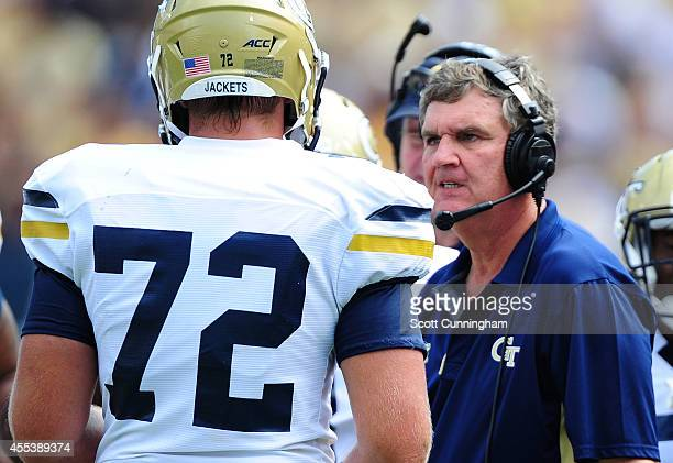 Head Coach Paul Johnson of the Georgia Tech Yellow Jackets discusses a play with Chris Griffin during the game against the Georgia Southern Eagles at...