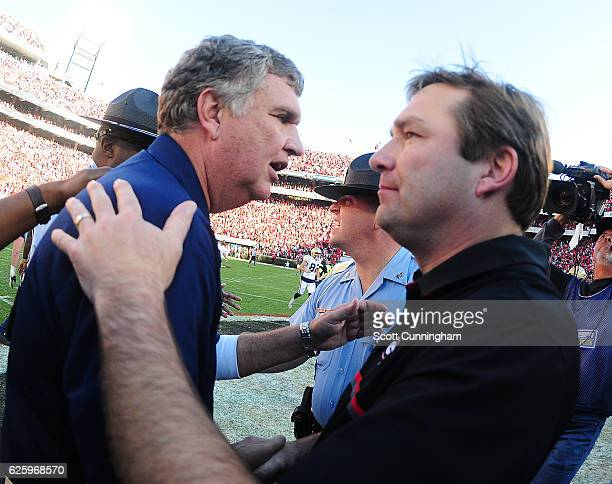 Head Coach Paul Johnson of the Georgia Tech Yellow Jackets is congratulated after the game by Head Coach Kirby Smart of the Georgia Bulldogs at...