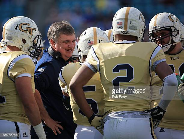 Head coach Paul Johnson of the Georgia Tech Yellow Jackets smiles during the first half of the game against the Kentucky Wildcats at EverBank Field...