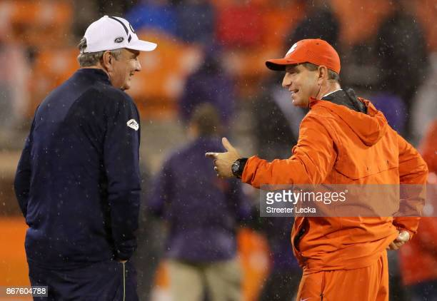 Head coach Paul Johnson of the Georgia Tech Yellow Jackets talks to head coach Dabo Swinney of the Clemson Tigers before their game at Memorial...