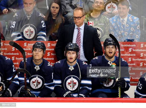 Head Coach Paul Maurice Brandon Tanev Andrew Copp and Adam Lowry of the Winnipeg Jets keep an eye on the play from the bench during third period...