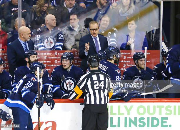 Head Coach Paul Maurice of the Winnipeg Jets discusses a call with referee Graham Skilliter during a second period stoppage against the Minnesota...