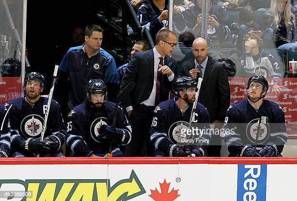 Head Coach Paul Maurice of the Winnipeg Jets discusses strategy with Assistant Coach Pascal Vincent during second period action against the Tampa Bay...