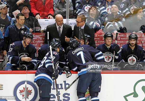 Head Coach Paul Maurice of the Winnipeg Jets gives instructions to his players during a second period stoppage in play against the New York Rangers...