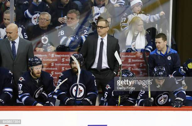 Head Coach Paul Maurice of the Winnipeg Jets looks on from the bench during second period action against the Pittsburgh Penguins at the MTS Centre on...