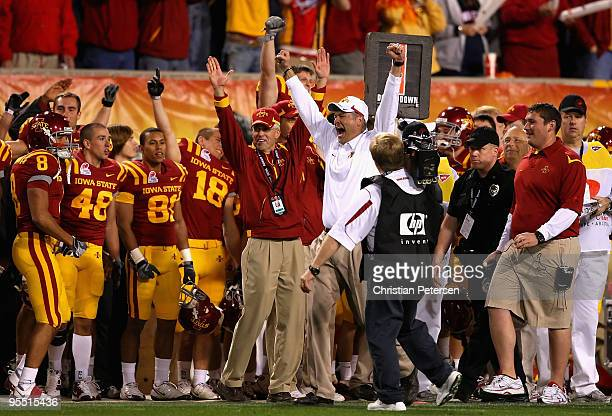 Head coach Paul Rhoads of the Iowa State Cyclones celebrates with teammates after defeating the Minnesota Golden Gophers in the Insight Bowl at...