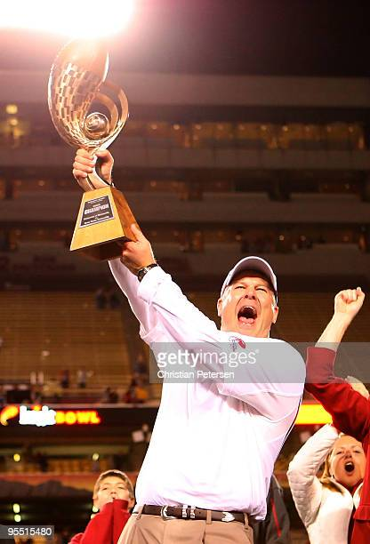 Head coach Paul Rhoads of the Iowa State Cyclones celebrates with the Insight Bowl trophy after defeating the Minnesota Golden Gophers at Arizona...