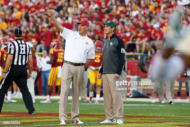 Head coach Paul Rhoads of the Iowa State Cyclones, left, and head coach Art Briles of the Baylor Bears meet at mid field during warm ups at Jack...